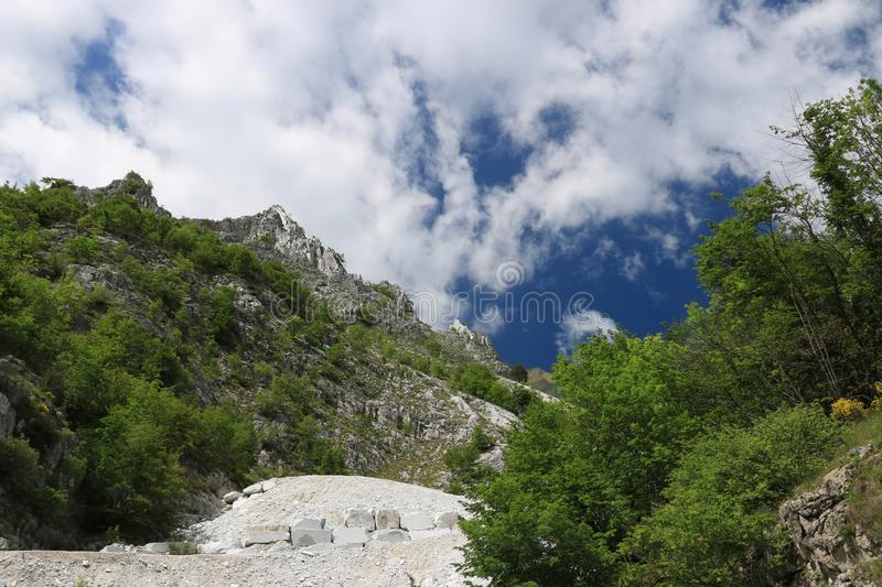 White Carrara marble quarry in the Apuan Alps. A mountain peak n stock images
