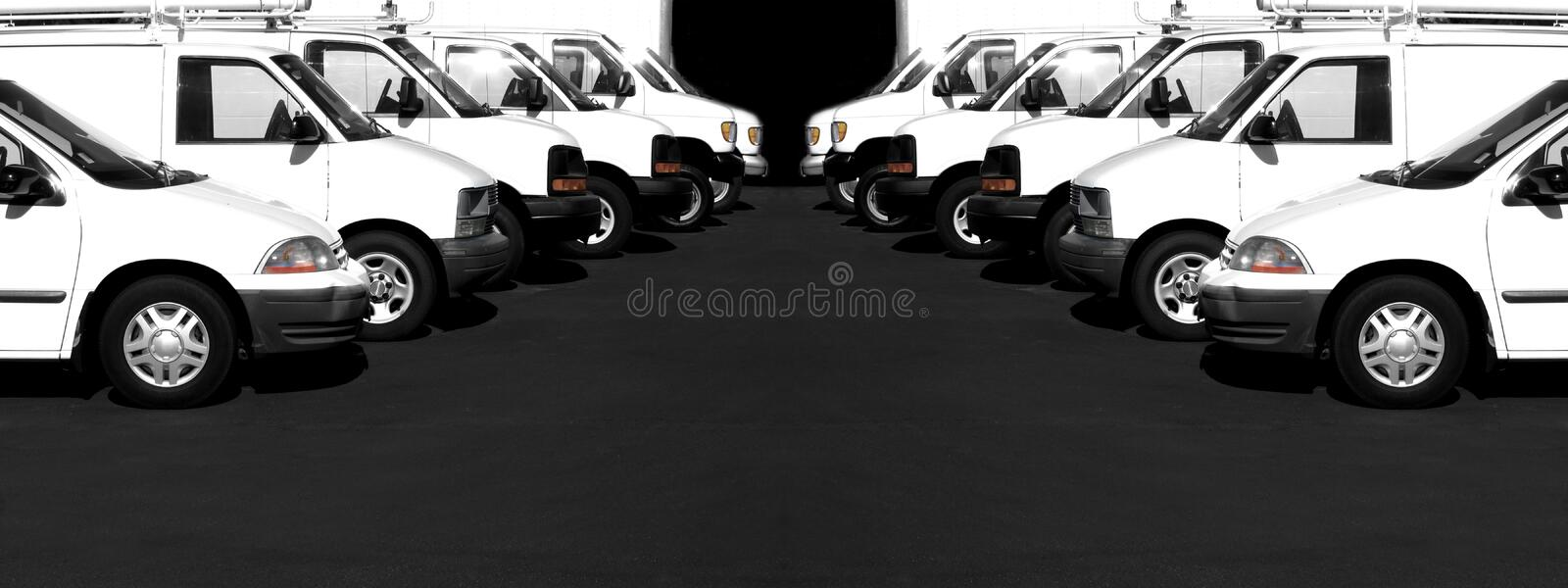 White Cars and Vans in a Row Parking Lot royalty free stock images