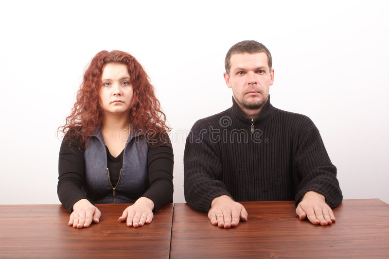 White casual couple sitting at the casual table stock images