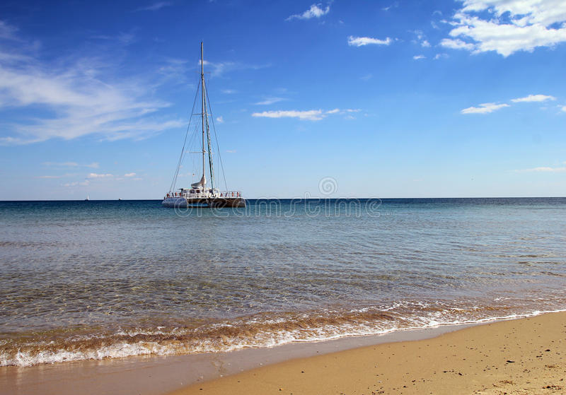 White catamaran near to the beach stock photo