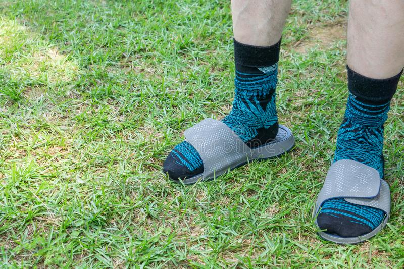 White caucasian man wearing socks with sandals. Male fashion mistake, copy space royalty free stock photos