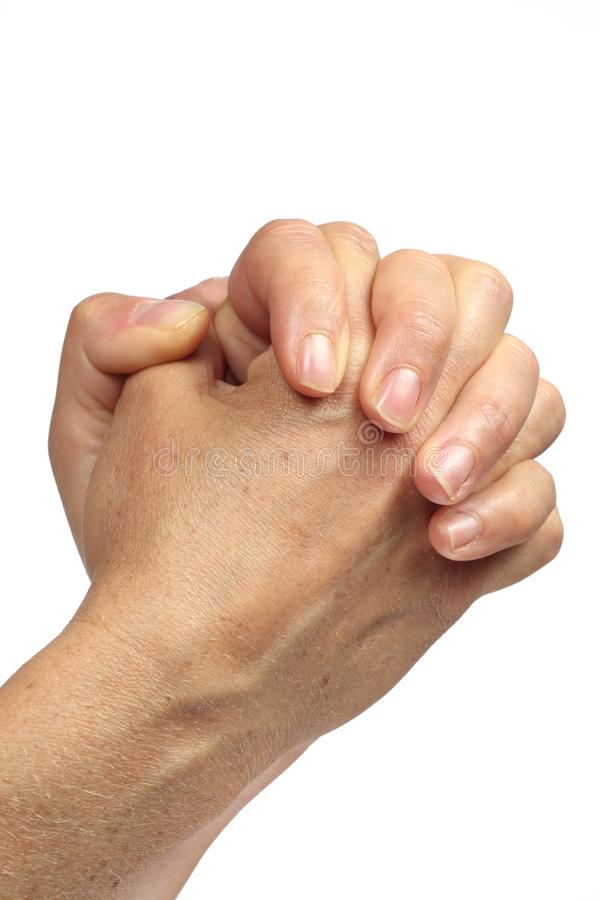 White Caucasian-type hand joined to beg passers-by and make begging or pray god or virgin in church. Hands in prayer symbolizing plea and isolated imploration on stock images