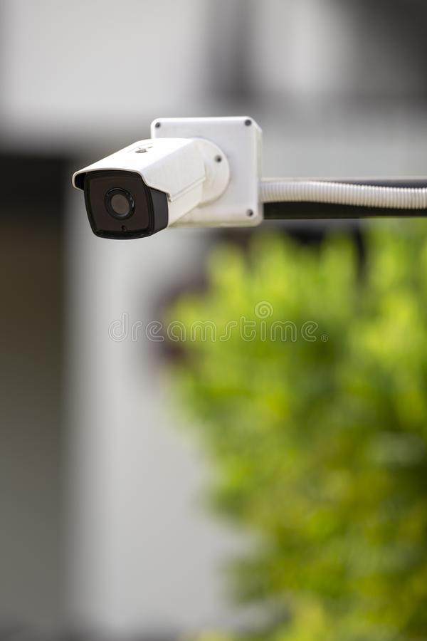 White CCTV outdoor operating with support arm outdoor stock image