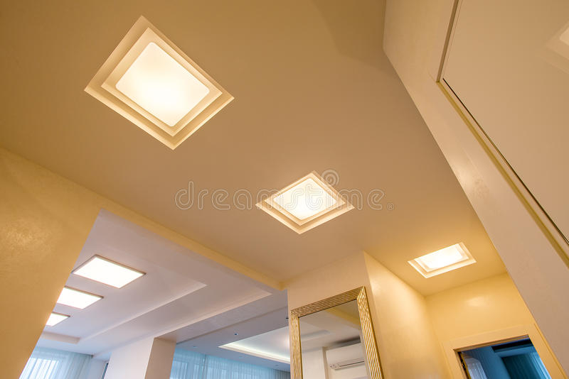 White ceiling illuminated with LED stock photos