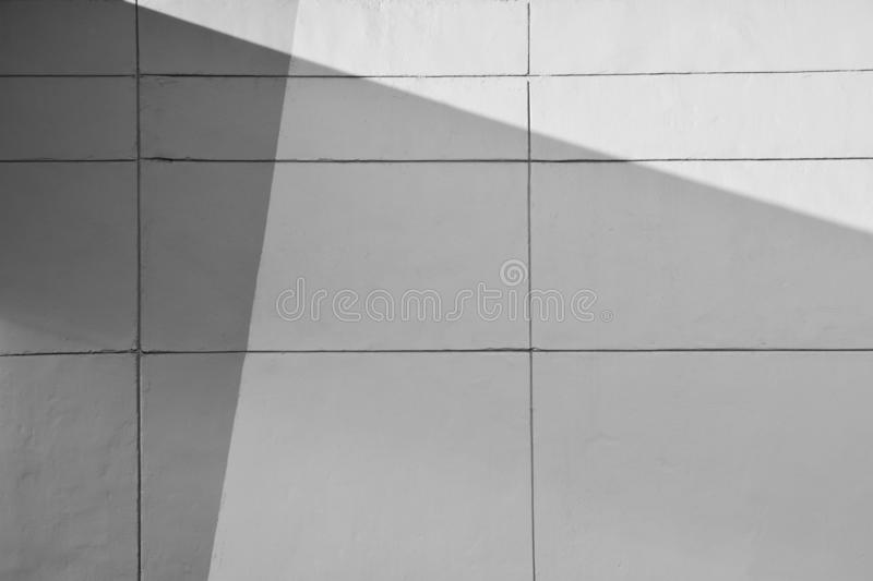 White cement wall with line and shadow. stock images