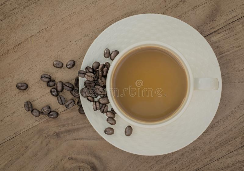 White Ceramic Coffee Cup on Brown Wooden Panel royalty free stock photography