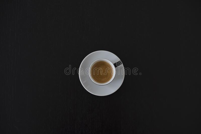 White Ceramic Coffee Cup on White Saucer royalty free stock photography