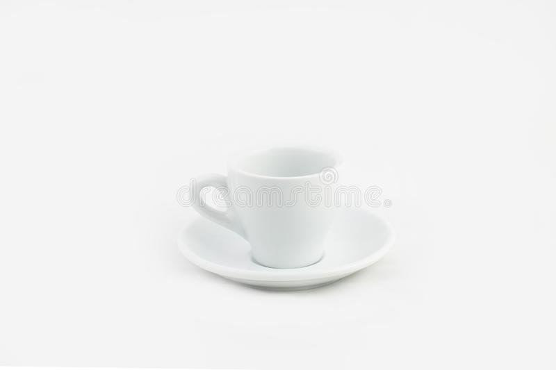 White ceramic coffee cup on a saucer isolated on a white background. A white ceramic coffee cup on a saucer isolated on a white background stock images