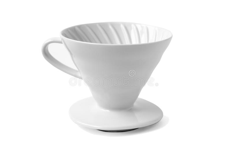 White ceramic coffee dripper isolated on white background. White ceramic pour-over brewer used with a paper filter for preparing brewed coffee by letting hot stock images