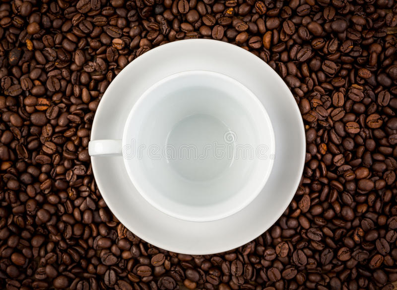 White ceramic cup on coffee. Background royalty free stock photo