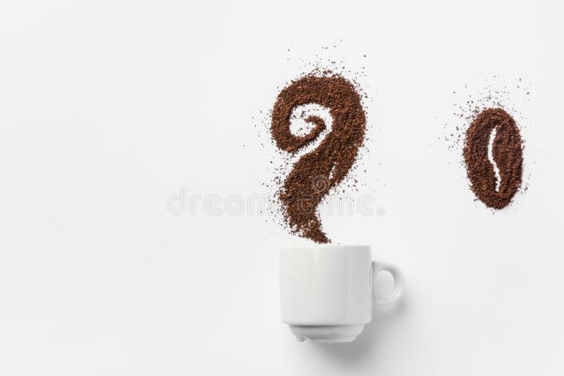 White ceramic cup of coffee with curly steam and bean made from grounds. Creative food artwork. Breakfast energy concept stock photo