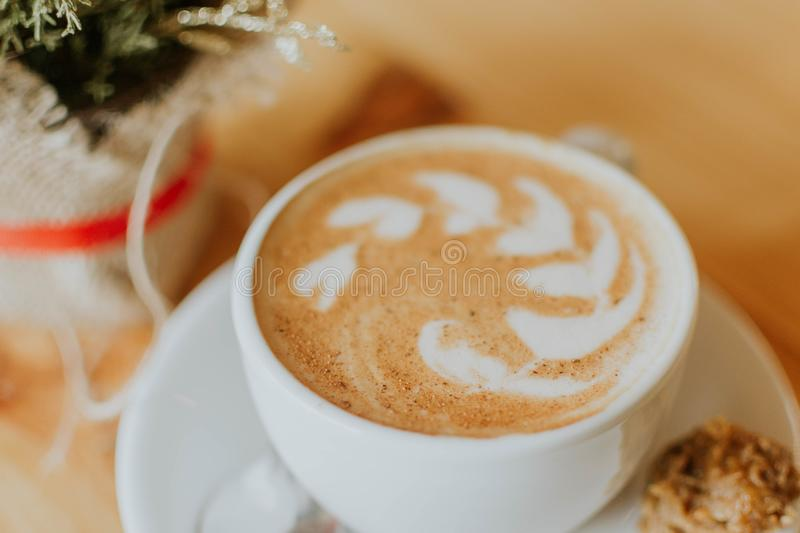White Ceramic Cup With Coffee Latte royalty free stock image