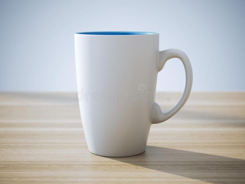 White ceramic cup stands on table. White ceramic cup stands on wooden table stock image