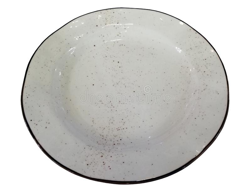 A white ceramic dish with a brown rim and brown spray. Beautiful tableware. Kitchen utensils royalty free stock images