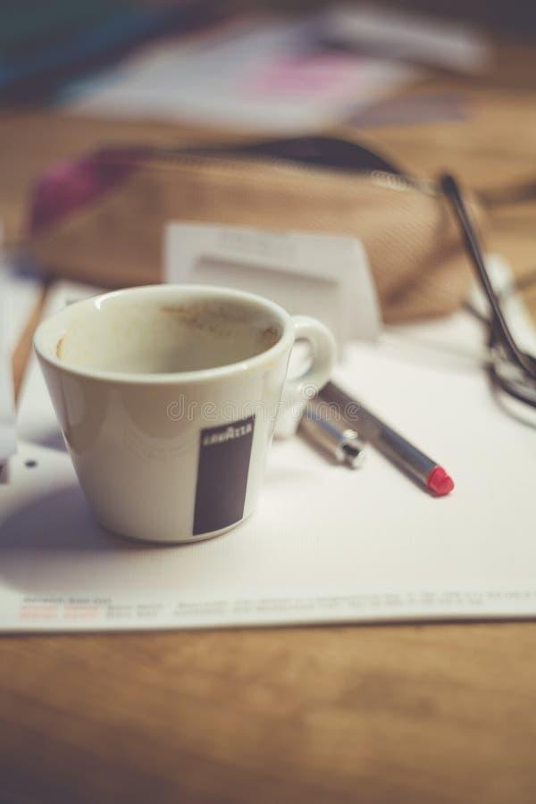White Ceramic Mug on White Table Near Grey Pen stock photo