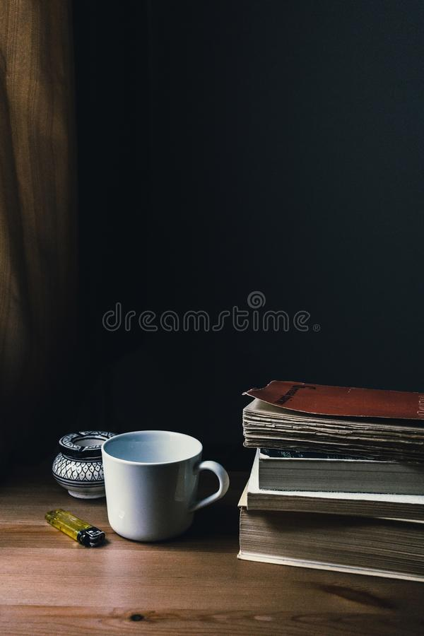 White Ceramic Mug and Yellow Disposable Lighter royalty free stock photo