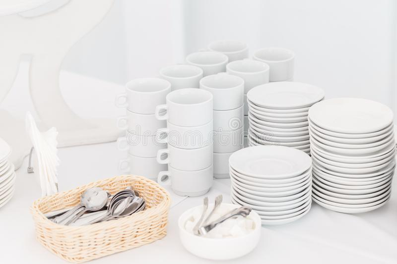 White ceramic mugs. Group of empty coffee cups. White cup for service tea or coffee in breakfast or buffet and seminar royalty free stock photo