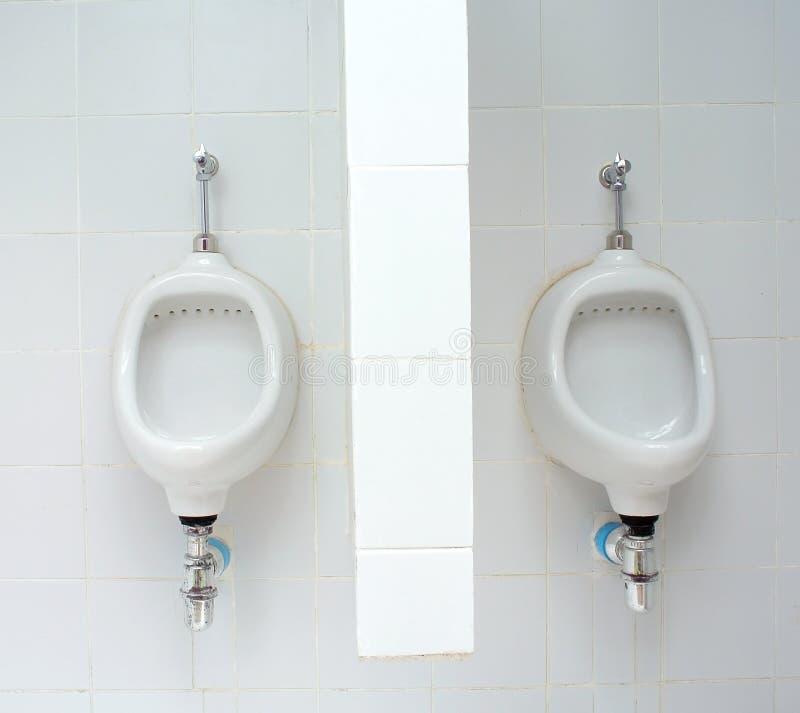 White ceramic sanitary ware. In restroom royalty free stock photo