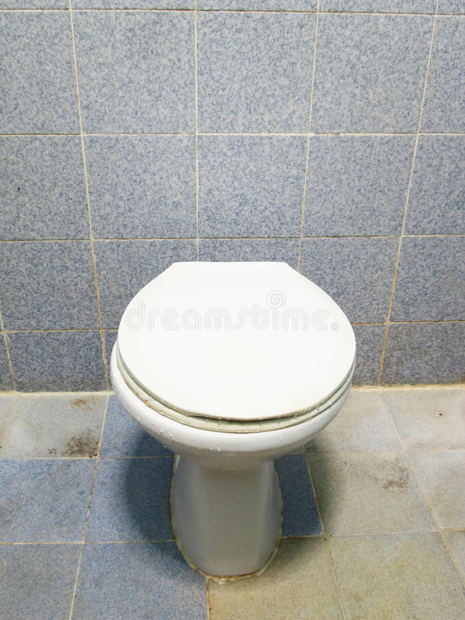 White ceramic sanitary ware and tissues in Blue bathroom. White ceramic sanitary ware and tissues in old Blue bathroom stock photos