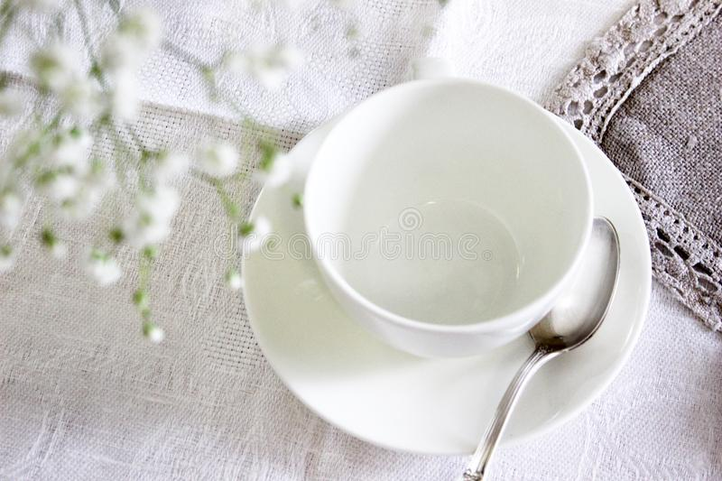 White Ceramic Tea Cup With Saucer and Spoon royalty free stock photography