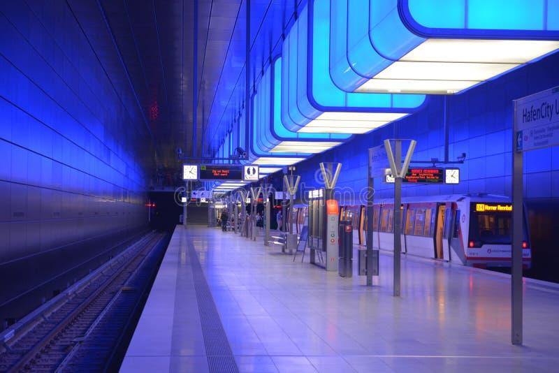 White Ceramic Tiles Near Black Train Rail royalty free stock image
