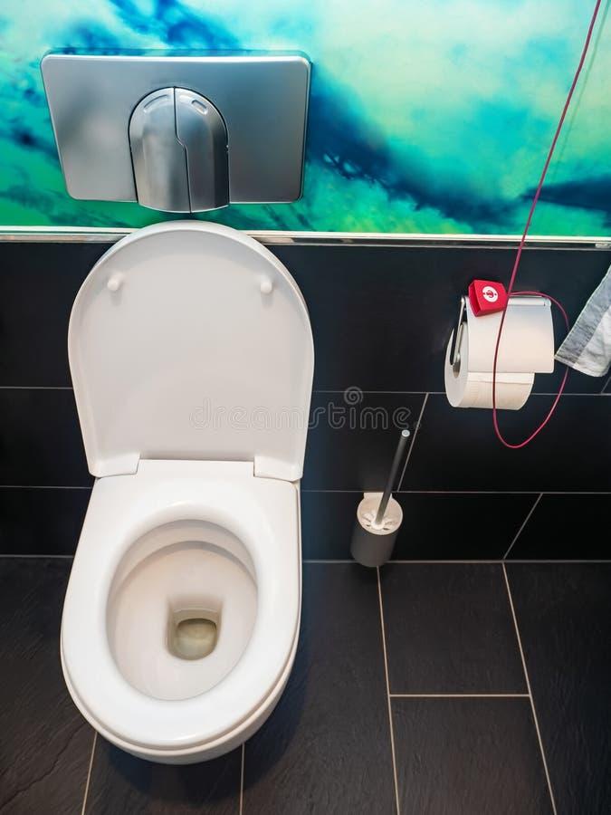White ceramic toilet bowl stock photography