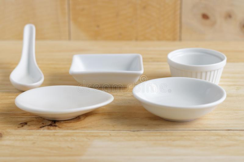 White ceramic ware on wooden table. Font view royalty free stock photos