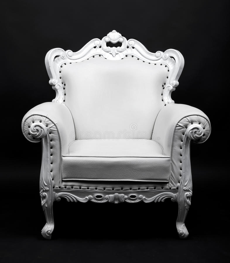 White chair. White leather decorative chair on black background