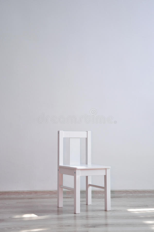 Download White Chair In An Empty Room Stock Photo