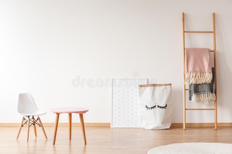White chair and pink table royalty free stock photos