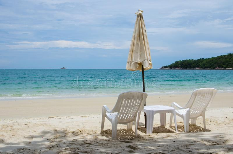 White chair with umbrella. On beach royalty free stock photos