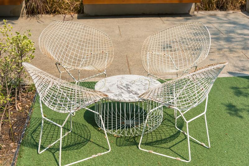 White Chairs and Table in the Garden.  stock photo