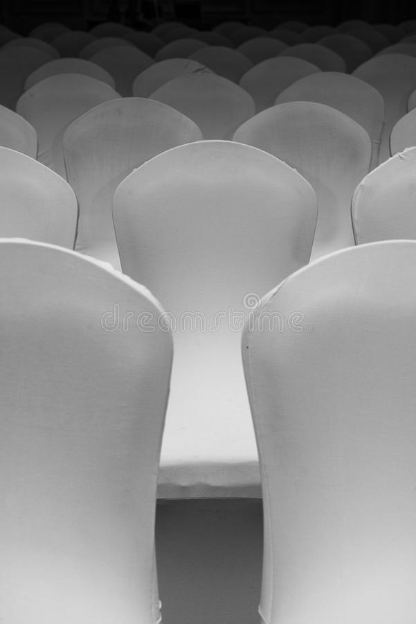 White Chairs Under Soft Light stock image
