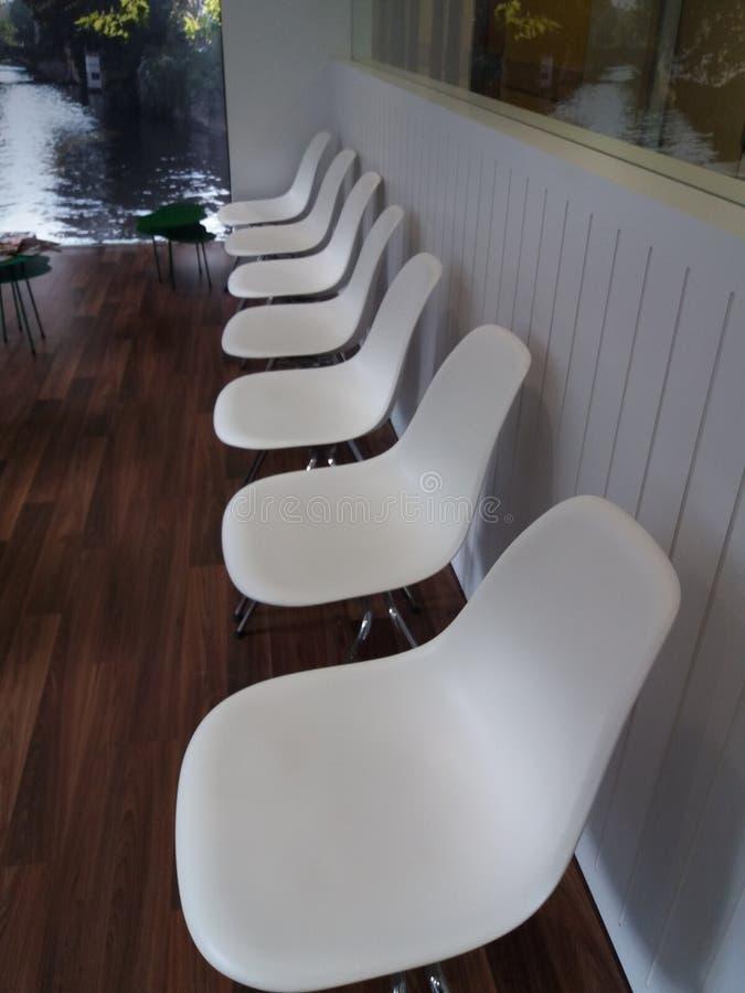 White chairs royalty free stock photos