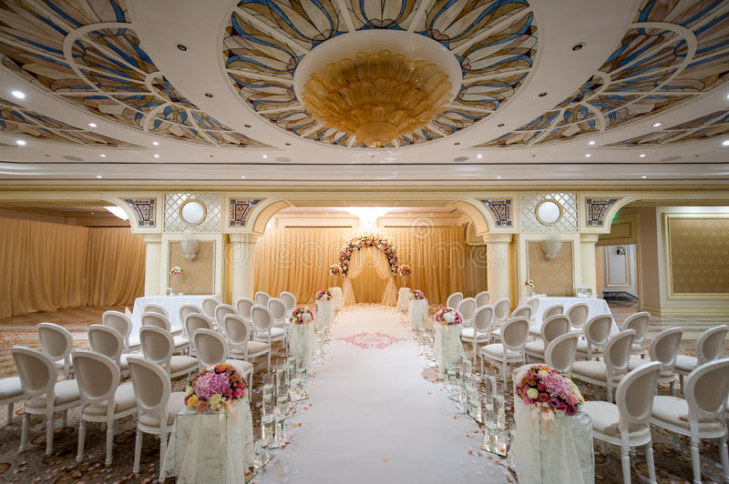 All White Indoor Wedding Ceremony Site: White Chairs At A Wedding Indoor. Stock Photo