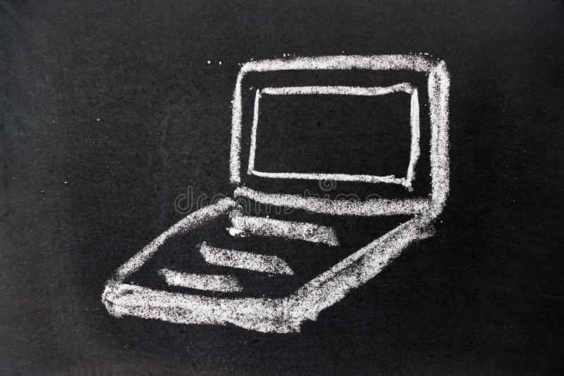 White chalk drawing as notebook shape on black board background stock image