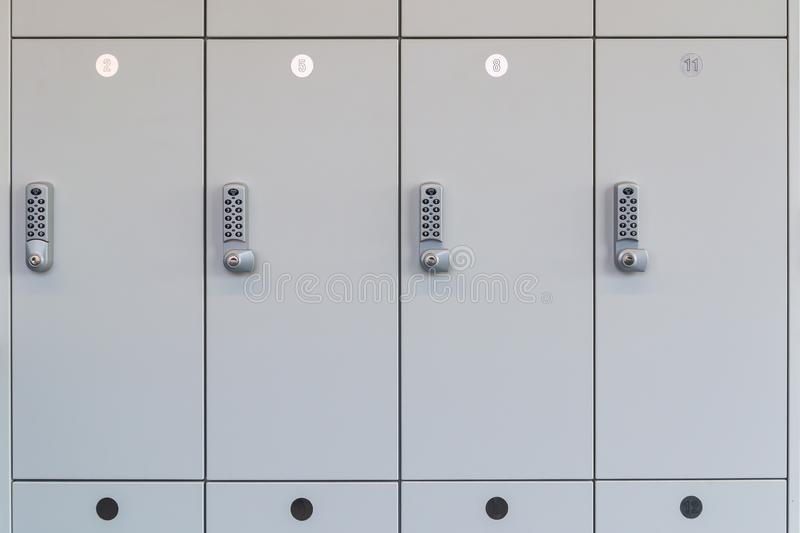 White change room lockers with electronic access control in a public room like the wardrobe in a changing room royalty free stock photo
