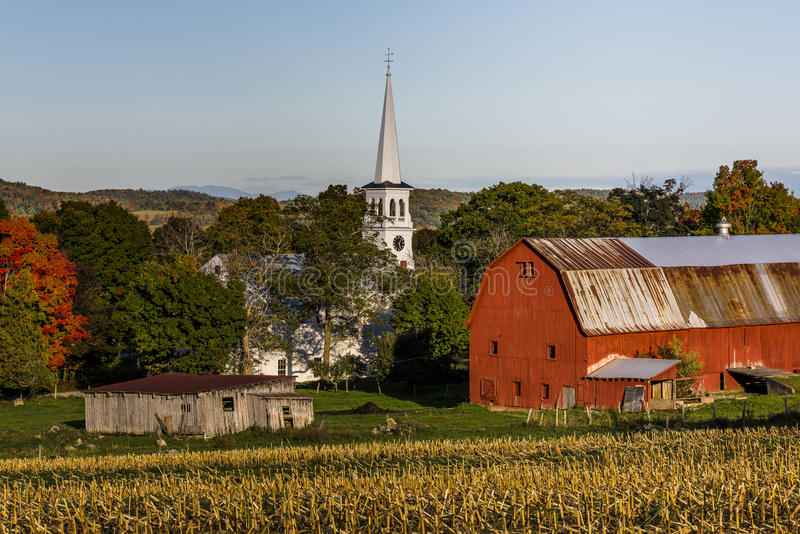 White Chapel, Red Barns and Farm Fields at Sunset - Peacham, Vermont stock images