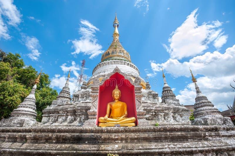 White chedi and golden Buddha statue at Wat Buppharam, Chiang Ma stock photos