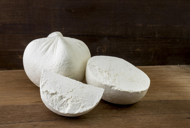White cheese. Traditional hard/dry white cheese called mizithra. Fresh cheese made with milk and whey from sheep and/or goats milk stock photos