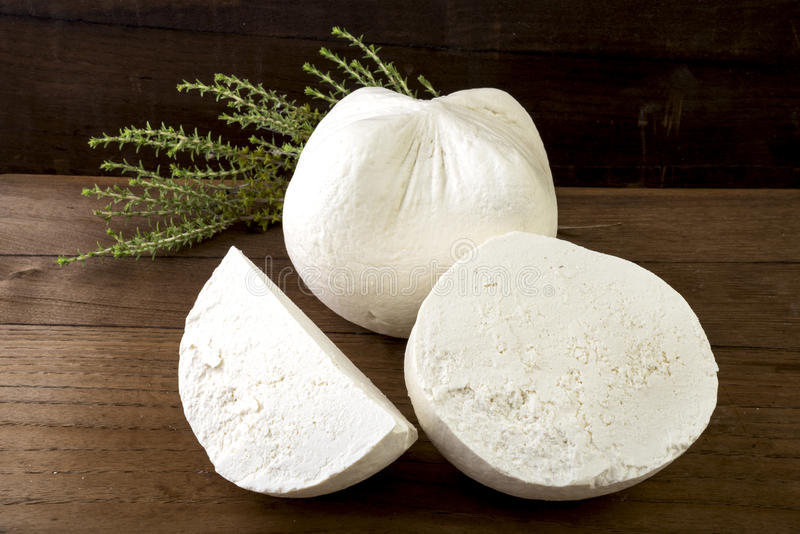 White cheese. Traditional hard/dry white cheese called mizithra. Fresh cheese made with milk and whey from sheep and/or goats milk royalty free stock photos