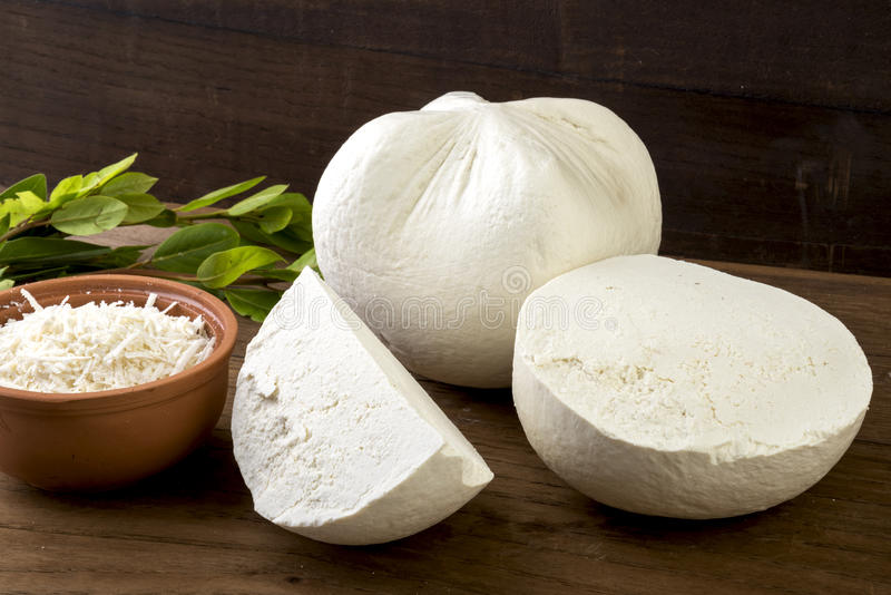 White cheese. Traditional hard/dry white cheese called mizithra. Fresh cheese made with milk and whey from sheep and/or goats milk stock image