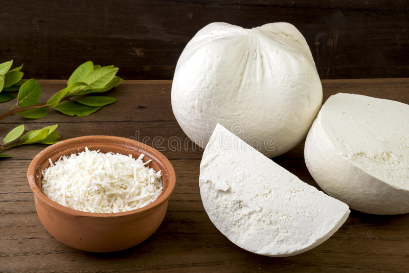 White cheese. Traditional hard/dry white cheese called mizithra. Fresh cheese made with milk and whey from sheep and/or goats milk royalty free stock photo