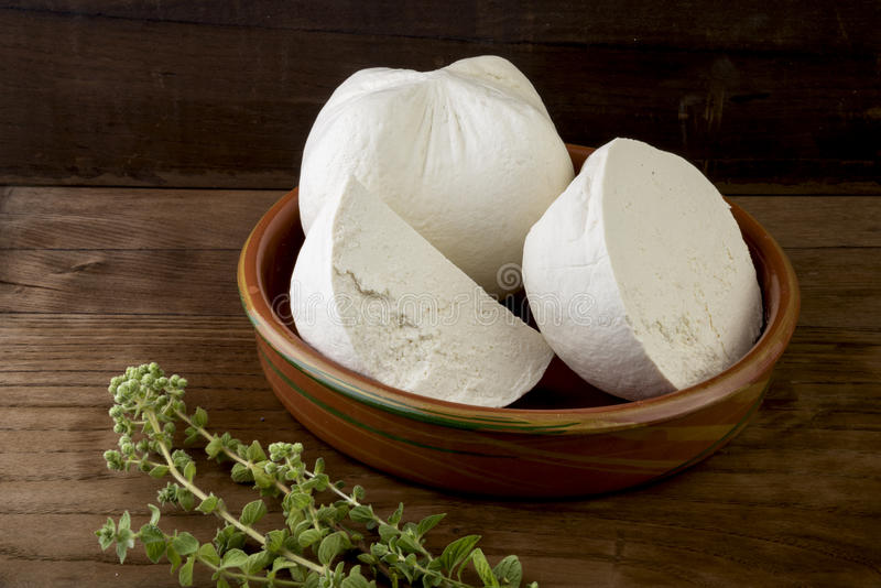 White cheese. Traditional hard/dry white cheese called mizithra. Fresh cheese made with milk and whey from sheep and/or goats milk royalty free stock image