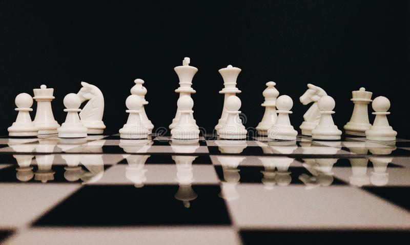White Chess Piece on Top of Chess Board stock photography
