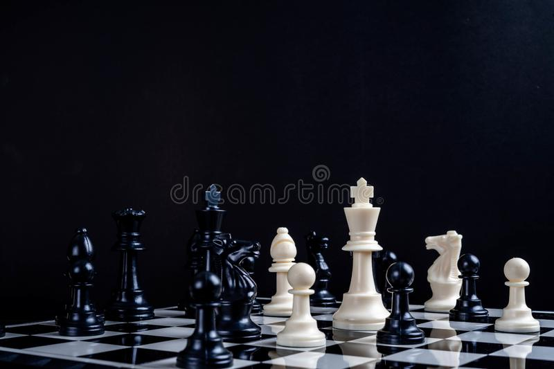 A white chess teame and black chess team ,idea for business competition and team work royalty free stock images