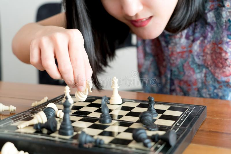 The white chess on women hand is fighting with black, think, discuss, committed, competition, winner, successful, dedicate concept. The white chess on woman hand royalty free stock photo