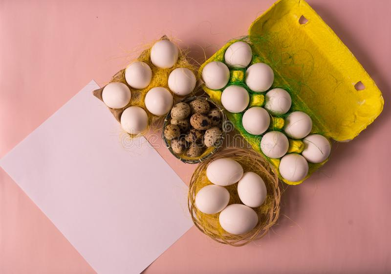 White chicken Chicken and quail eggs in colored paper eco-friendly packaging with sisal Close-up photo Easter background. White chicken Chicken and quail eggs in royalty free illustration