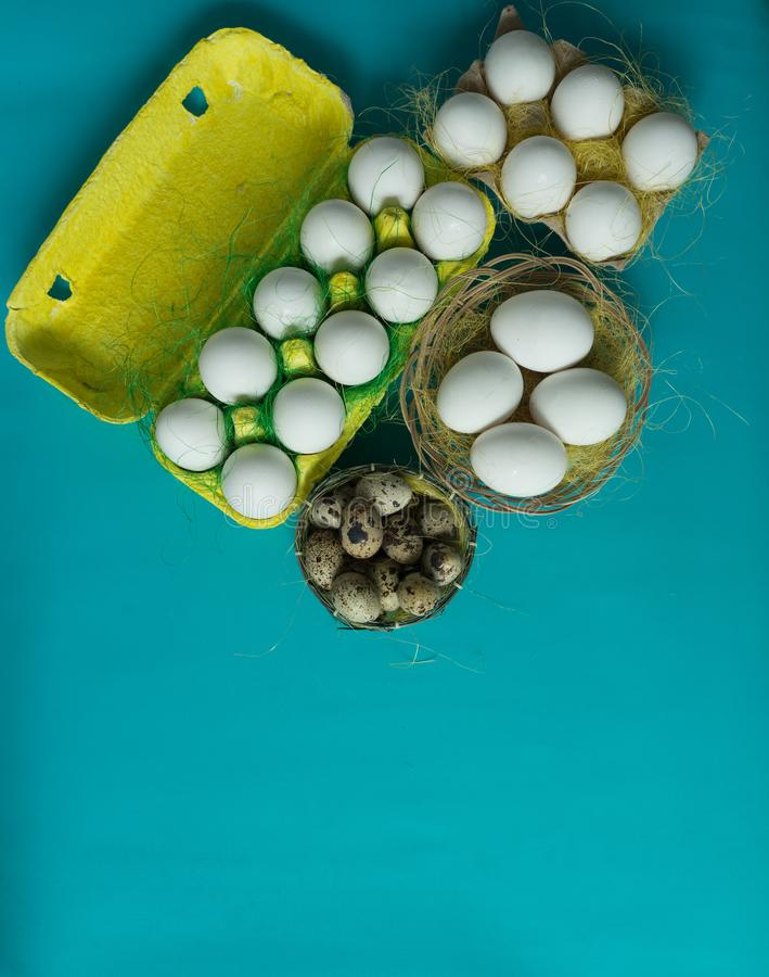 White chicken Chicken and quail eggs in colored paper eco-friendly packaging with sisal Close-up photo Easter background. White chicken Chicken and quail eggs in stock illustration