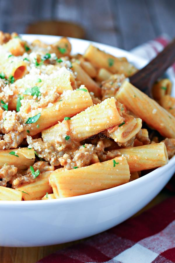 Rigatoni with Italian Sausage in serving dish stock photos